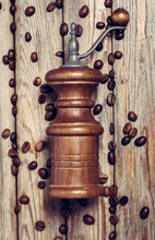 Hand-held Vintage Coffee Grinder On A Wooden Table