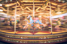 Motion Blurr Of Vintage Carousel Horse Of Amusement Ride On Merry-go-round Carousel. Amusement Concept