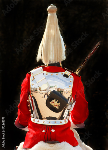 Fotografía  Back View of a Grenadier guard in uniform with brass armour and feather helmet