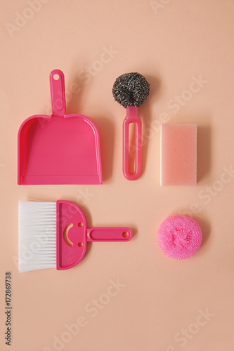Flatlay Collection Of Pink Household Cleaning Items Arranged On Bacground