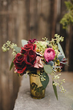 Pink And Red Wedding Bouquet In A Gold Vase