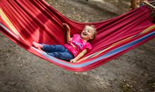 Summer Vacation - Lovely Girl In Hammock In The Garden