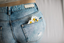Woman With Flowers In The Pocket