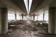 Mud Under A Highway Bridge Cross A River