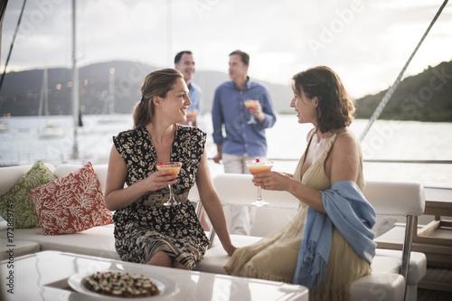 Women drinking on yacht