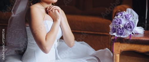 Fényképezés A Christian girl in a white dress makes a prayer, Female hands are folded in a prayerful gesture