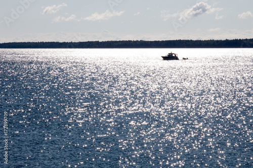 Silhouette of a boat in a sunny reflection in Lake Superior