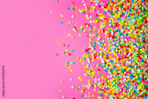 Obraz Frame made of colored confetti. Pink background. - fototapety do salonu