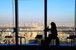 Cityscape of Shinjuku, Aoyama area behind a women in a cafe. カフェの女性越しの新宿、青山方面の景色