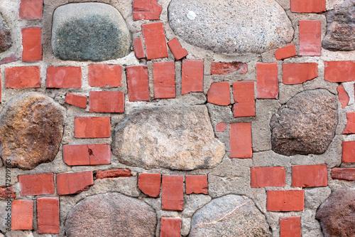 Plakaty Wall of bricks and stones