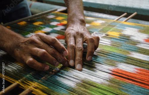 Fotografiet  weaving and manufacturing of handmade carpets closeup