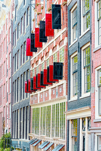 Black and typical red window doors open on a street in Amsterdam Canvas Print