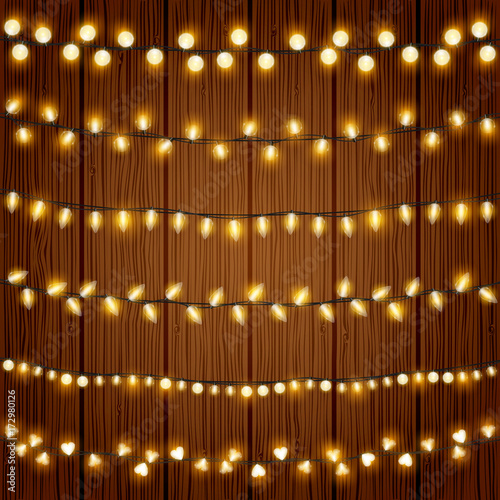 Realistic Christmas lights vector set. Festive decorative Xmas light bulbs chains design element collection with transparent warm shine. Wall mural