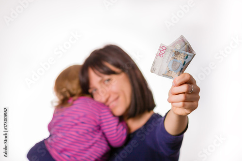 Photo Mother with little daughter holds in hand 500 zloty banknote