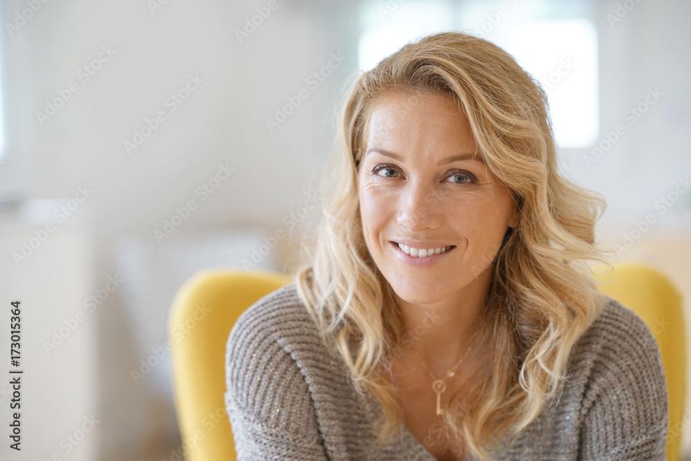 Fototapeta Portrait of beautiful 40-year-old blond woman