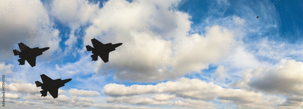 Fototapety, obrazy: Silhouettes of three F-35 aircraft against the blue sky and white clouds