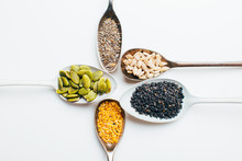 Different Seeds In Spoons.
