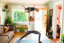 Super Mom Doing Yoga With Son