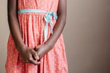 Black Girl Wearing A Peach Polka Dot Dress