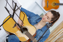 Pretty Young Woman With Guitar