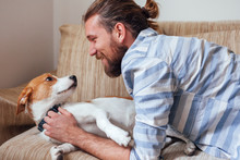 Man Having Fun With His Jack Russell Dog