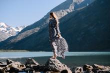 Woman In Long Dress Standing O...