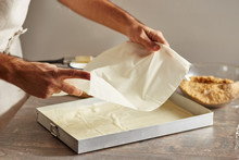 Man Placing Filo Sheets Into B...