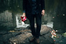 Man's Holding Roses