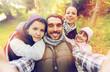 Leinwandbild Motiv family with backpacks taking selfie and hiking