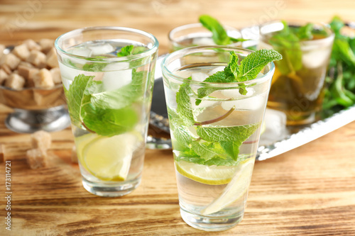 Valokuva  Two glasses with mint julep on wooden table
