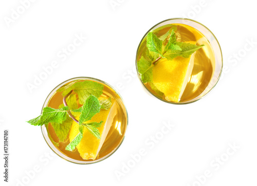Valokuva  Two glasses with mint julep on white background