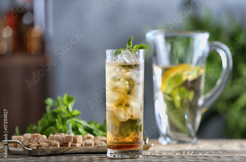 Valokuvatapetti Long glass with mint julep on kitchen table