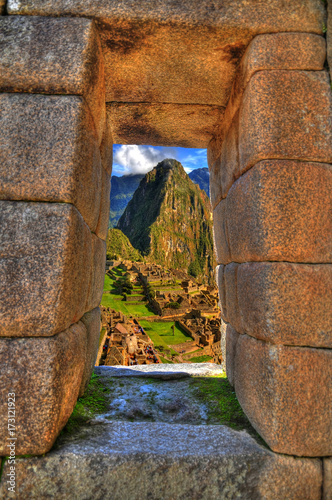 Fotografie, Obraz  Colorful HDR image of the ruins of Machu Picchu near Cusco, Peru through a windo