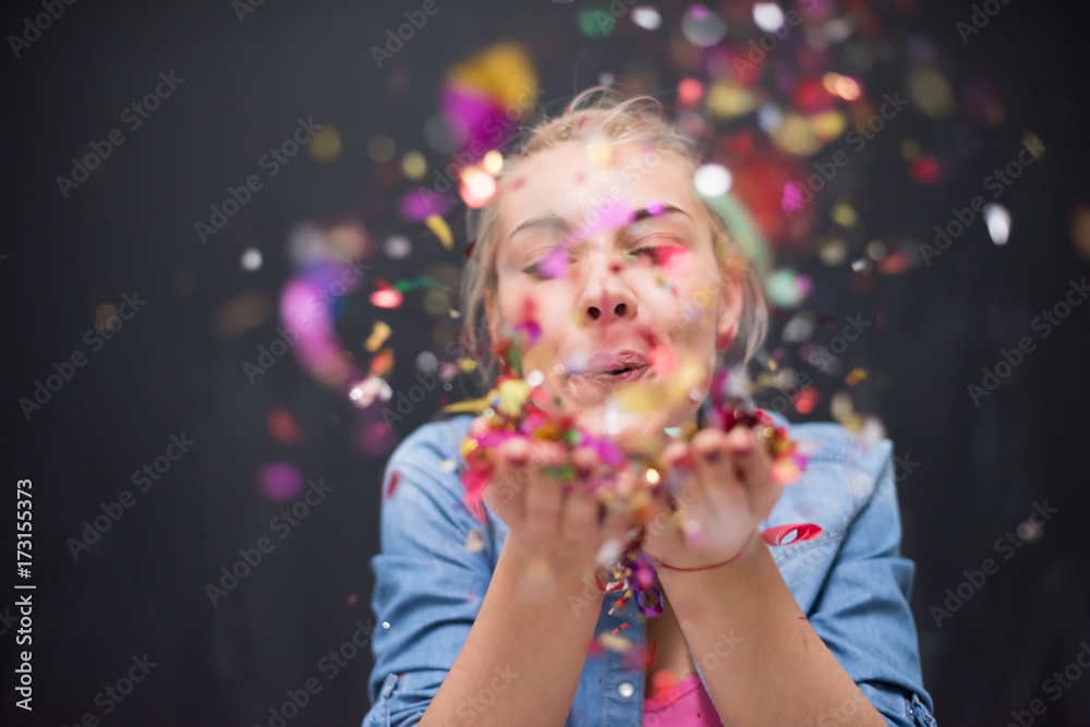 Fototapety, obrazy: woman blowing confetti in the air