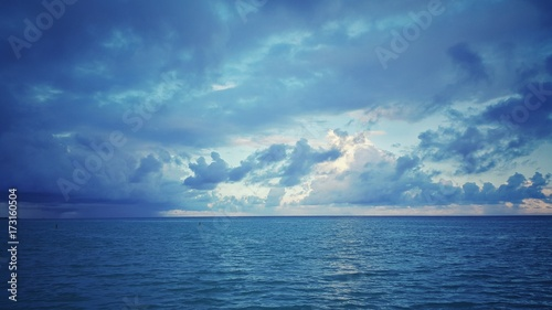 Photographie Sea sunrise over the atlantic ocean. Rainy clouds.