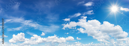 blue sky with clouds and sun reflection Wallpaper Mural
