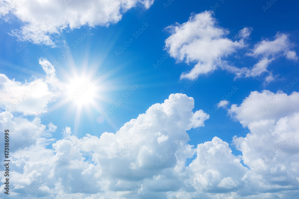 Fototapeta blue sky with clouds and sun reflection.The sun shines bright in the daytime in summer