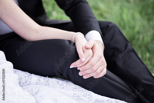 Bride and groom holding hands outdoors Wallpaper Mural