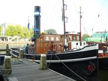Old Steam Tugboat Docked At Pier