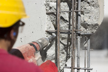 Construction Worker Using A Drilling Power Tool