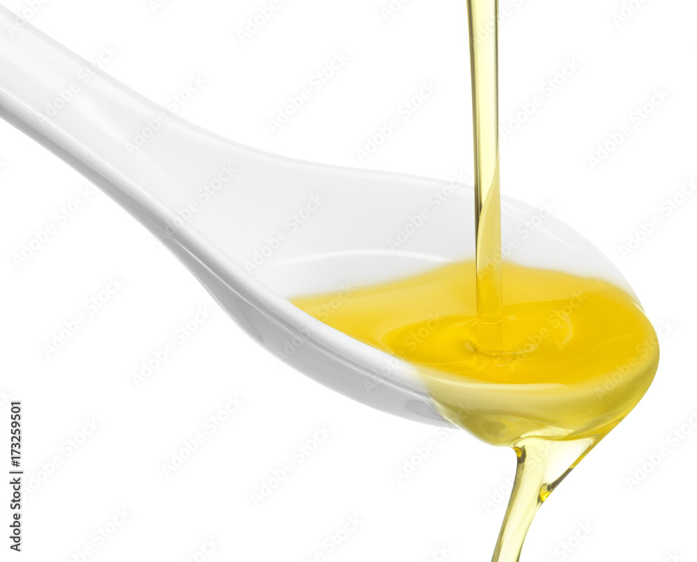Fototapety, obrazy: olive oil overflowing from a spoon isolated on white