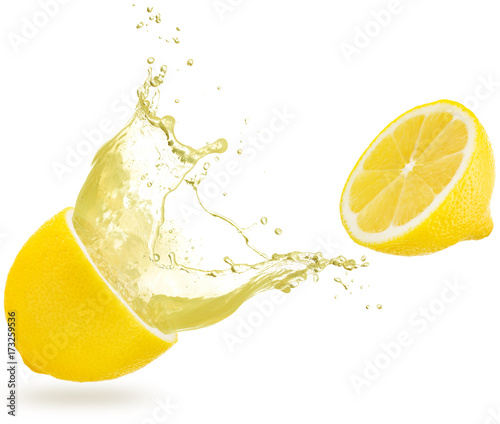 juice spilling out of a lemon isolated on white