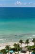 Beautiful view on ocean beach from a balcony. Tropical landscape. Clean, golden sand on the Atlantic ocean, clean, azure sea, tropical sun.