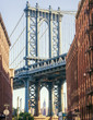 Empire State building through the Manhattan Bridge, NY