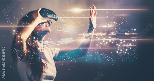 Photo  Digital Screen with young woman using a virtual reality headset