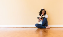 Young Woman Reading A Book In ...