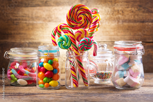 Foto auf Leinwand Süßigkeiten Colorful candies, jellies, lollipops, marshmallows and marmalade in a glass jars