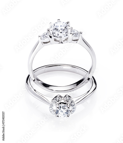Two Diamond Engagement Wedding Rings On Isolated White