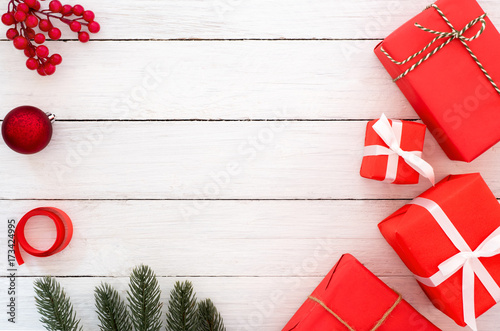 christmas and new year background christmas presents in red boxes with decoration rustic elements on