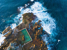 Aerial View Of North Curl Curl Rockpool With Surrounding Waves.